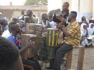 African drummers drumming in a drum circle, a tradition that is affected by cultural appropriation