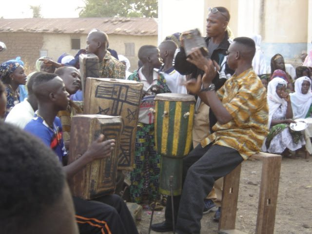 African drummers in Togo playing music to inspire travel