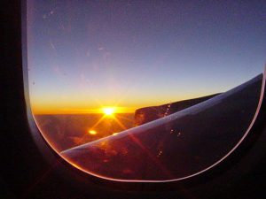 A sunset view from an airplane window on an overseas family trip
