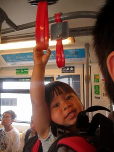 Father and baby riding a subway on an overseas family trip
