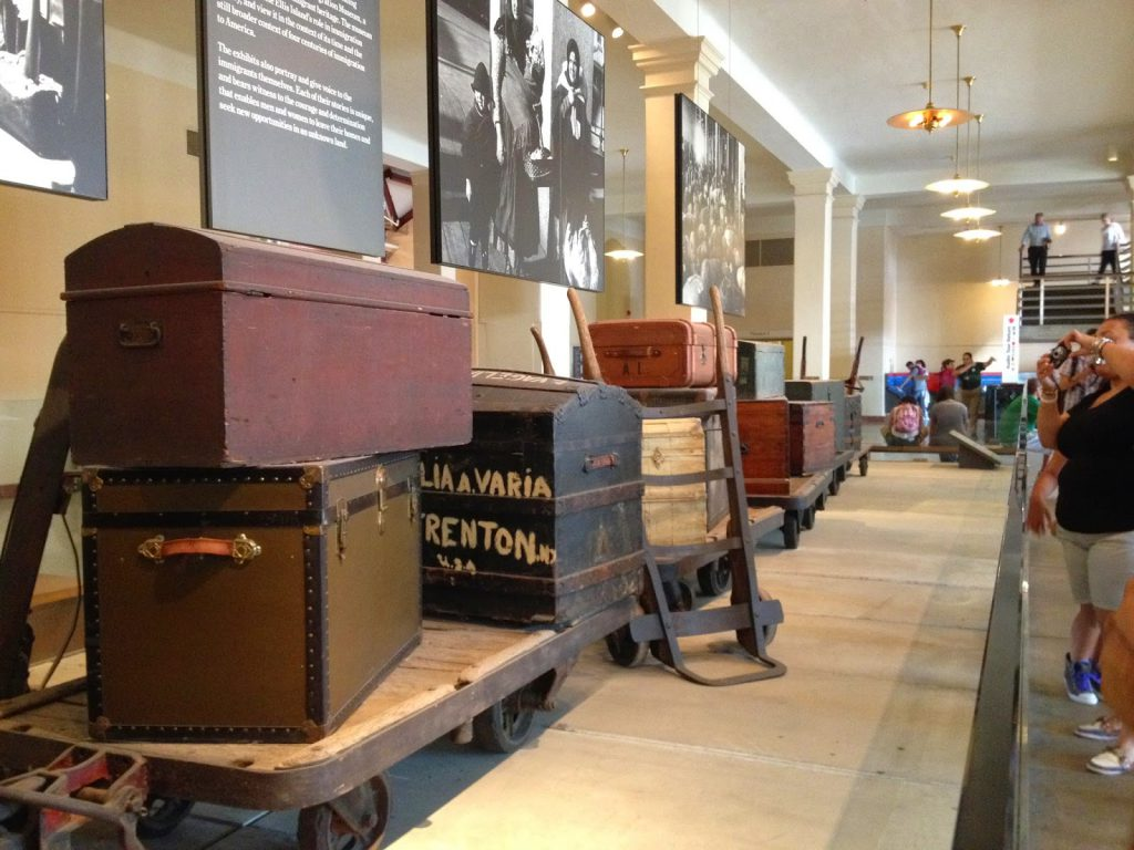 Old trunks stacked on display as part of an exhibit at Ellis Island, one of the popular kid friendly activities in New York City