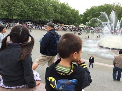 Kids looking at the International Fountain at the Seattle Center, one of the water activities in Seattle for families