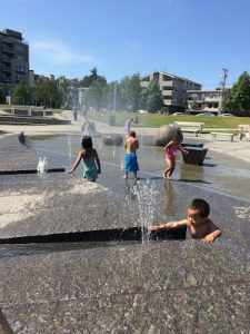 Kids playing at Ballard Commons Park in Seattle, one of the many water activities in Seattle that families can do