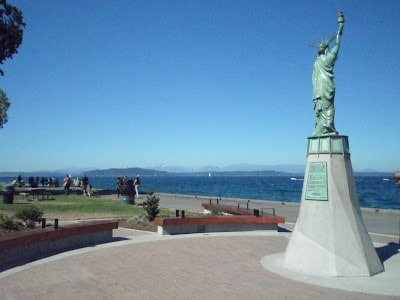 Statue of Liberty replica overlooking Alki Beach in Seattle, where there are  many water activities in Seattle for families to do