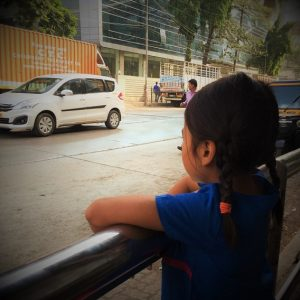 A child waiting for an Uber, a sharing economy travel app