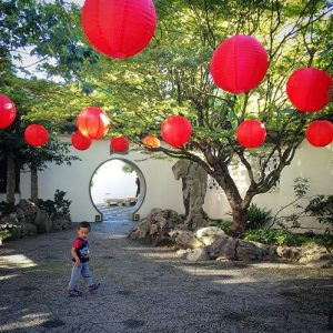 Child at the Chinese Garden, one of the top things to do in Portland, Oregon
