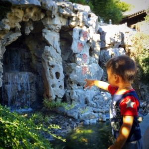 A child doing things to do in Portland with kids at Lan Su Chinese Garden