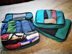 Packing cubes filled with clothes for RTW family travel