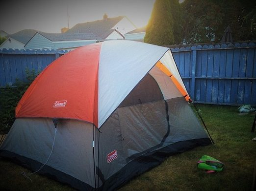 Backyard tent camping for family bonding activities