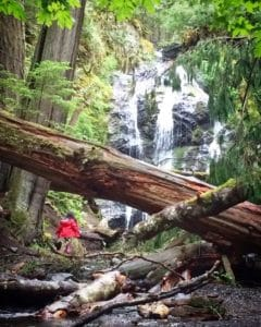 A child exploring Washington state parks camping spots at Moran State Park