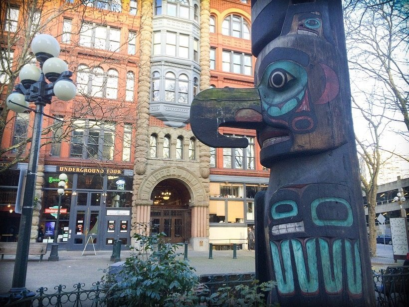 A totem pole in downtown Seattle, WA, U.S.A. in front of the entrance to  the Underground Tour, one of the activities in Seattle for families
