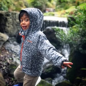 A kid plays in Kubota Gardens, one of the many outdoors activities in Seattle