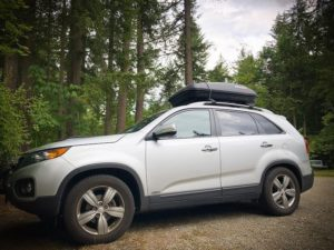 An SUV with a cargo box for traveling in minimalism