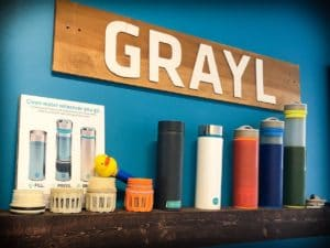 A shelf of GRAYL water bottles, camping essentials for clean water