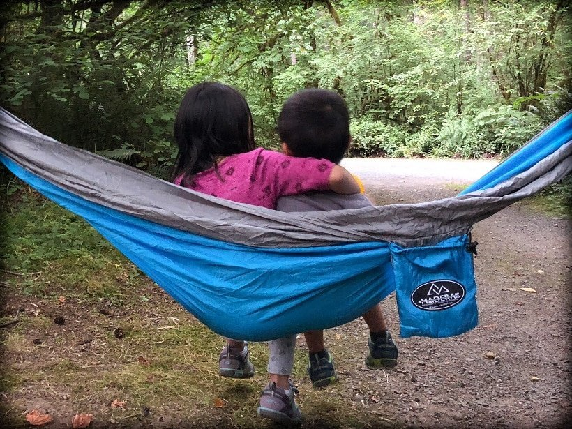 Two kids in a Madera foldable hammock
