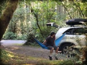 Man using Madera hammocks for family travel gear.
