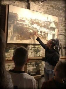 A tour guide explains Seattle history
