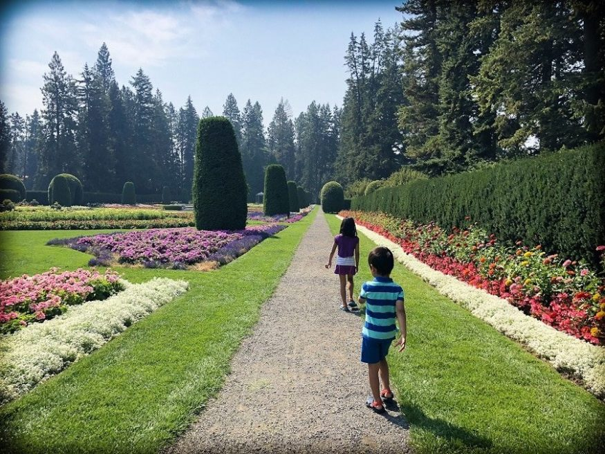 Children walking at a garden, an example of family friendly Spokane activities