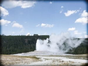 Old Faithful erupting, a must see sight for a Yellowstone day trip
