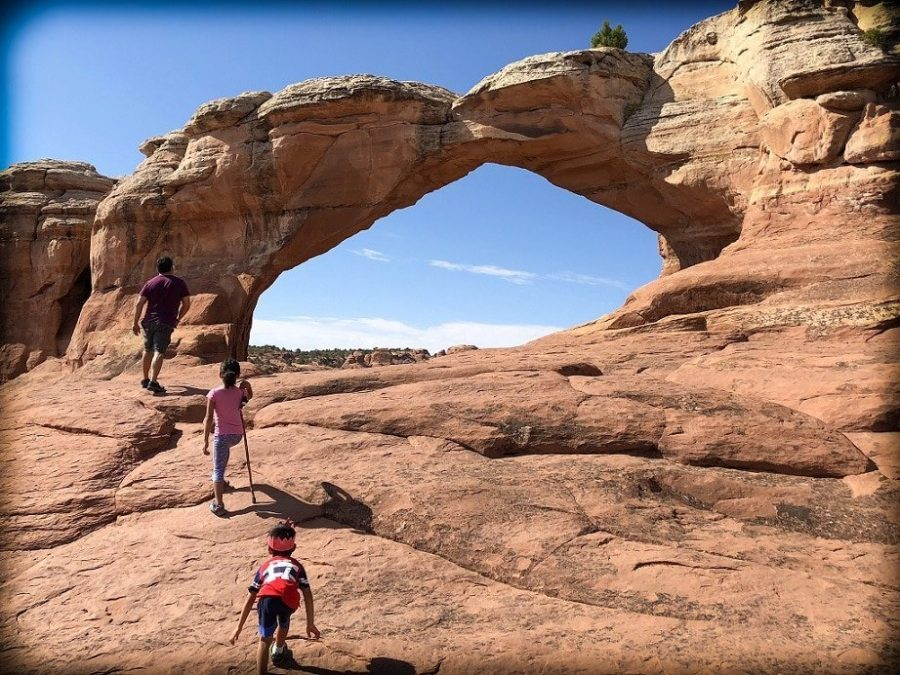 A world schooling family hiking at Arches National Park