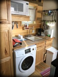 A kitchen in a tiny house, an example of unique family travel accommodations