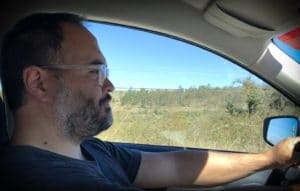 A man driving in Mexico on a road trip in Mexico
