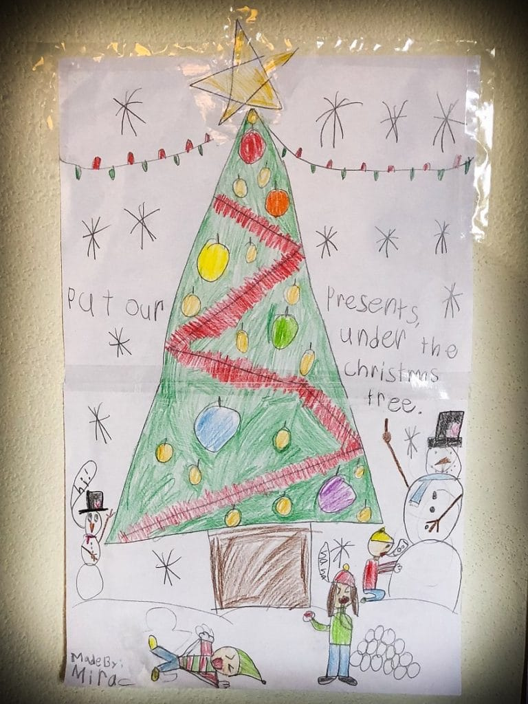 Christmas tree drawn by children celebrating Christmas holidays abroad