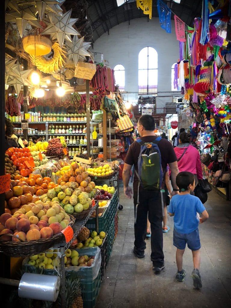 A man and boy walking through Mercado Hidalgo in Guanajuato,, Mexico, exploring things to do in Guanajuato