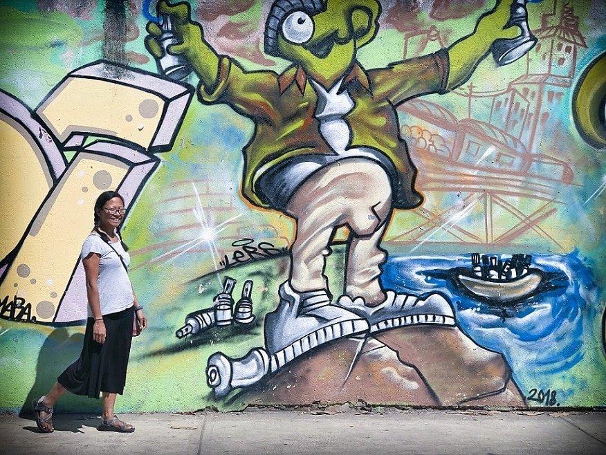 Working nomads exploring street art in Puerto Escondido, Mexico