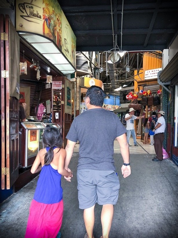 Walking through a market in San Jose while visiting Costa Rica with kids