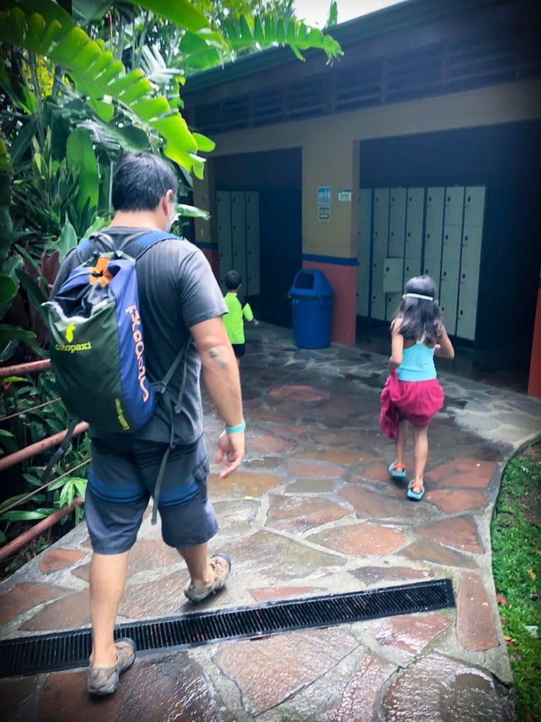 A man and a girl walking to the lockers at Kalambu hot springs