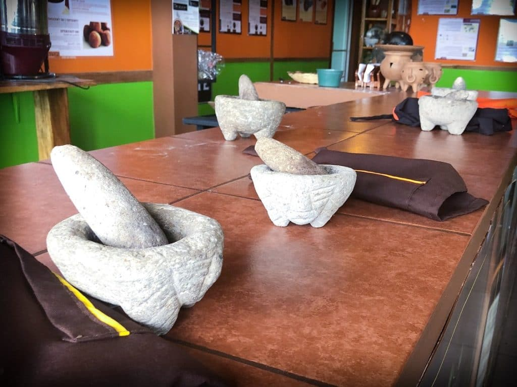 Mortars and pestles on a counter, in preparation for a chocolate workshop in La Fortuna, Costa Rica