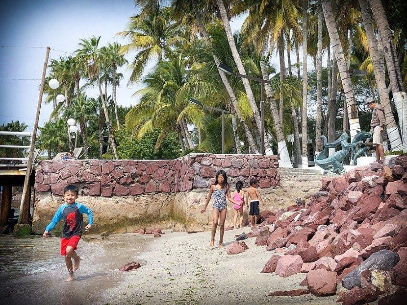 Beach play using resort day passes - The Wandering Daughter