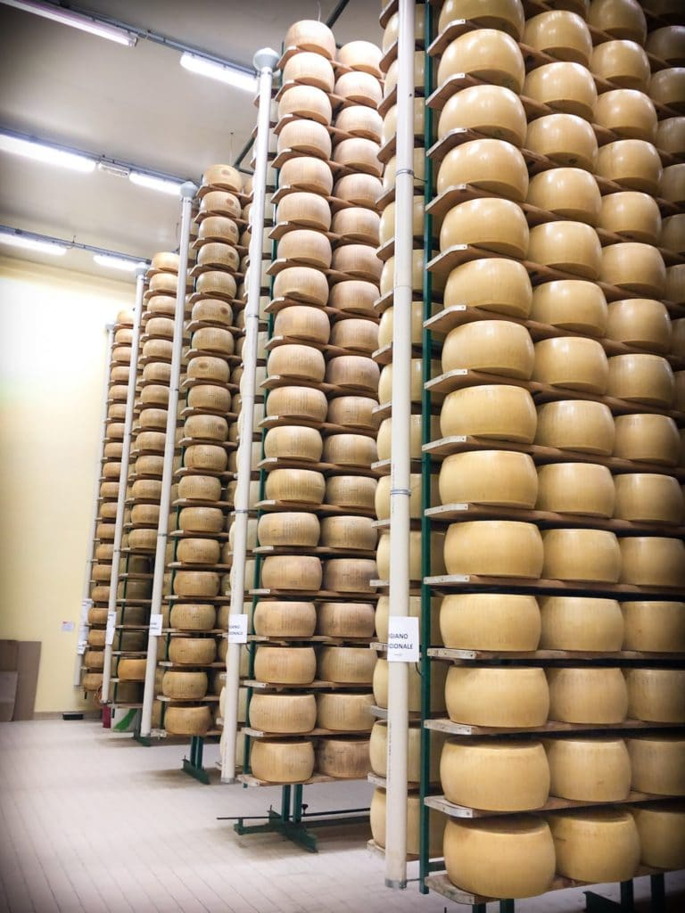 Stacks of parmesan wheels aging in a warehouse at a dairy in the Italian countryside