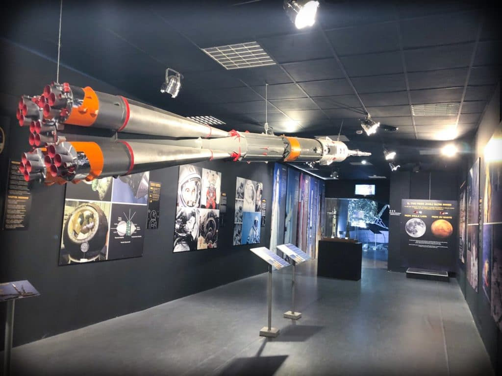 A rocket hanging from the ceiling as part of a space exhibit at a museum of aviation in Milan, Italy.