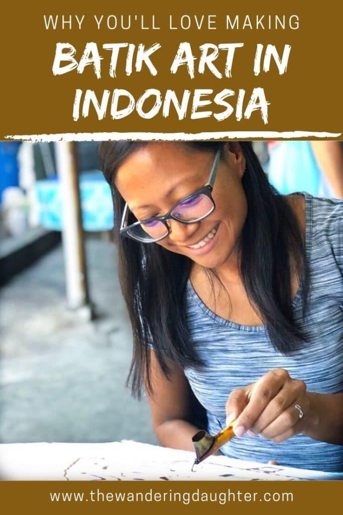 Why You'll Love Making Batik Art in Yogyakarta, Indonesia | The Wandering Daughter | Why families traveling to Yogyakarta, Indonesia will enjoy making batik art. Pinterest image of a woman printing a wax design for batik.