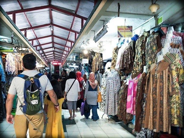 A man walking through Beringharjo Market in Yogyakarta, Indonesia, experiencing Indonesian culture