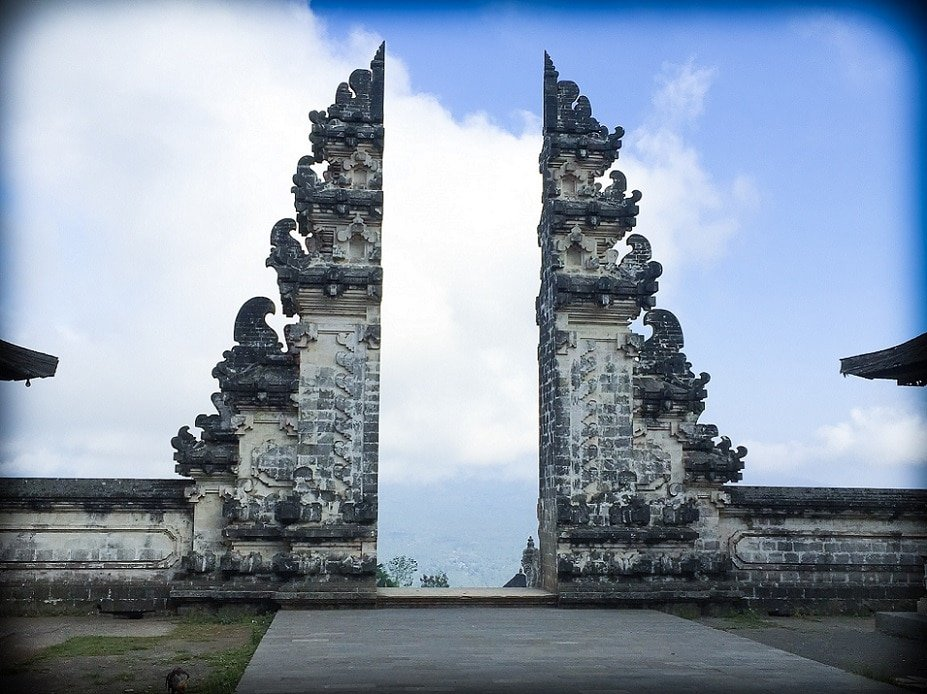 The iconic Gates of Heaven at Pura Lempuyang. Two Balinese temple gates, with the sky in the background.