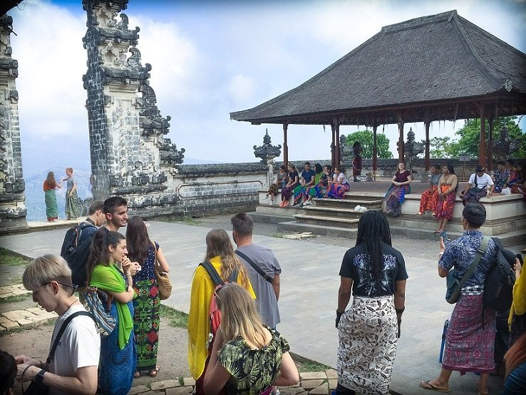 Visitors at Pura Lempuyang, the Gates of Heaven in Bali, Indonesia, waiting their turn for a photo opportunity between the two gates overlooking Mount Agung.