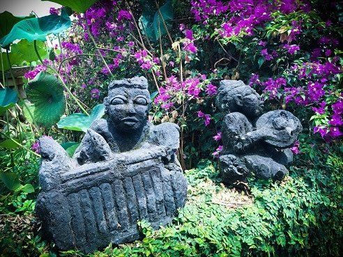 Small stone decorative carvings at a Bali eco stay in Padang Bai, Indonesia.