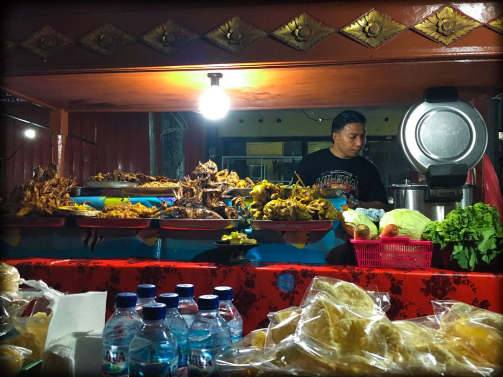 A food stall serving chicken, duck, and goat at a Bali night market in Gianyar, Indonesia