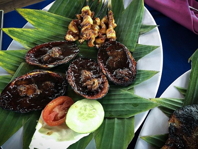 Traditional Sasak dish of clams. Trying out local dish a one of the popular things to do in Lombok.