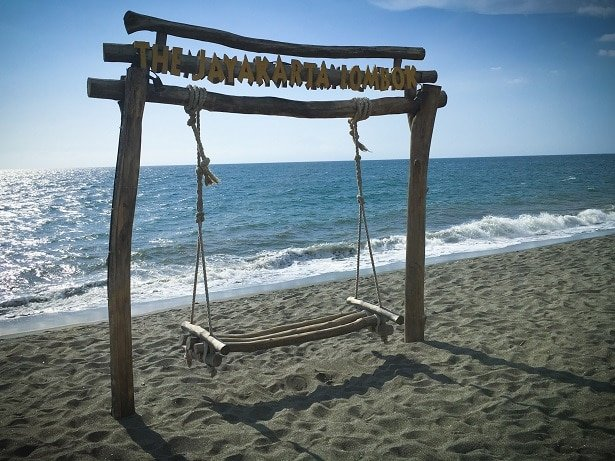 A swing on the beach, one of the things to do in Lombok, Indonesia.