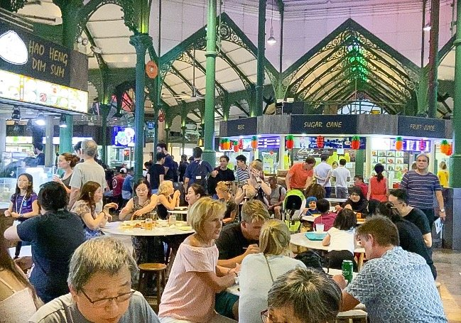 Diners at Lau Pa Sat hawker center, also known as Telok Ayer Market, one of the many food options for things to do in Singapore on a budget