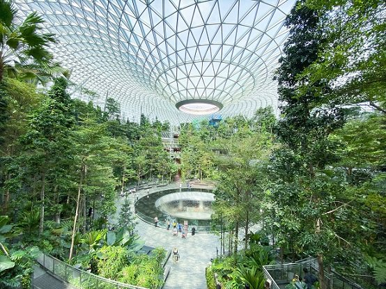 The indoor garden known as the Shiseido Forest Valley at Jewel in Changi Airport, with the Rain Vortex indoor waterfall in the center, one of the things to do in Singapore on a budget